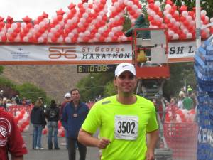 Nate crossing the finish line with his dad in back